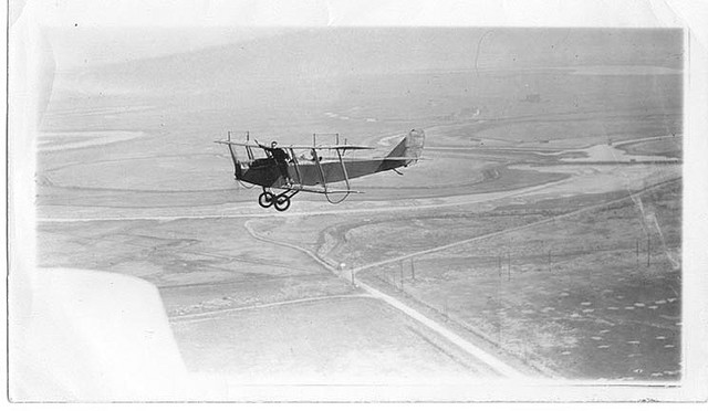 Charles P. Cooley on wing, over San Francisco peninsula by bay, out of San Carlos Airport; Sterling Price at controls